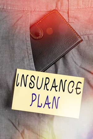 Writing note showing Insurance Plan. Business concept for includes the risk management that a worker is covered Small wallet inside trouser front pocket near notation paper Banque d'images