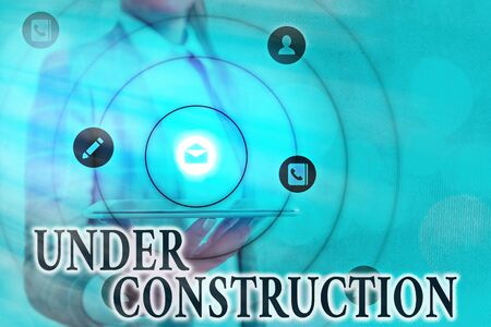 Text sign showing Under Construction. Business photo showcasing building that is unfinished but actively being worked on Information digital technology network connection infographic elements icon Фото со стока