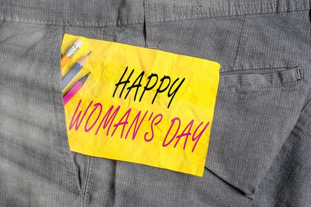 Word writing text Happy Woman S Day. Business photo showcasing to commemorate the essence of every lady around the world Writing equipment and yellow note paper inside pocket of man work trousers