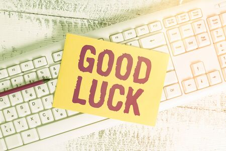 Text sign showing Good Luck. Business photo showcasing expressing hope for someone to be successful with their circumstances White keyboard office supplies empty rectangle shaped paper reminder wood Stock Photo