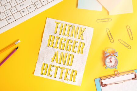 Conceptual hand writing showing Think Bigger And Better. Concept meaning have plans to be very successful or powerful Flat lay above copy space on the white crumpled paper Archivio Fotografico