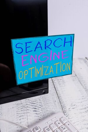 Word writing text Search Engine Optimization. Business photo showcasing Increase of business website traffic and analytics Notation paper taped to black computer monitor screen near white keyboard