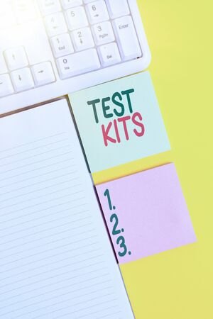 Word writing text Test Kits. Business photo showcasing tools used to detect the presence of something in the body Empty papers with copy space on yellow background table Banque d'images
