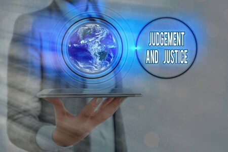Writing note showing Judgement And Justice. Business concept for law court proceedings to present evidence and finalize decision