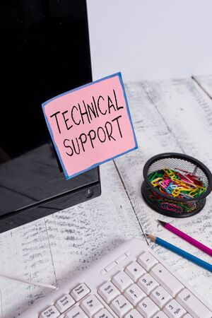 Handwriting text Technical Support. Conceptual photo a service provided by a hardware or software company Note paper taped to black computer screen near keyboard and stationary