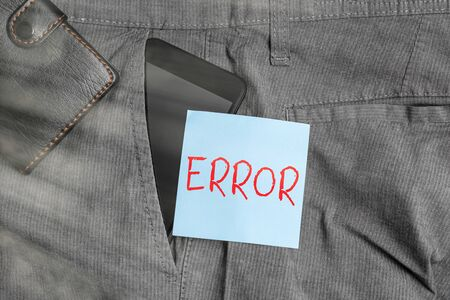 Conceptual hand writing showing Error. Concept meaning failure or in deviation from the intended performance or behavior Smartphone device inside trousers front pocket with wallet
