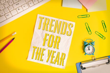Conceptual hand writing showing Trends For The Year. Concept meaning fashion styles or preferences for a period of time Flat lay above copy space on the white crumpled paper