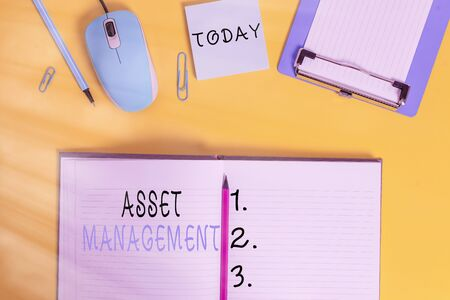Word writing text Asset Management. Business photo showcasing precise handling of resources for future economic benefits Clipboard sheet clip striped notepad mouse markers note colored background
