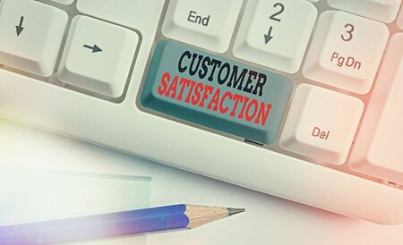 Writing note showing Customer Satisfaction. Business concept for number of users whose experience ratings exceed goals White pc keyboard with empty note paper above white key copy space Stok Fotoğraf