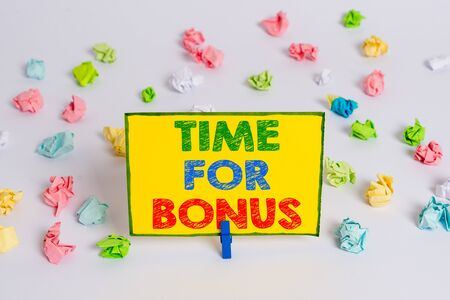 Writing note showing Time For Bonus. Business concept for Limited exclusive offer, extra discounts, crazy deal Colored crumpled paper empty reminder white floor clothespin