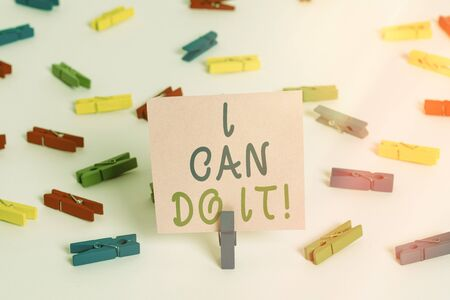 Writing note showing I Can Do It. Business concept for accomplish your work rather than complaining or giving up Colored clothespin papers empty reminder white floor background office