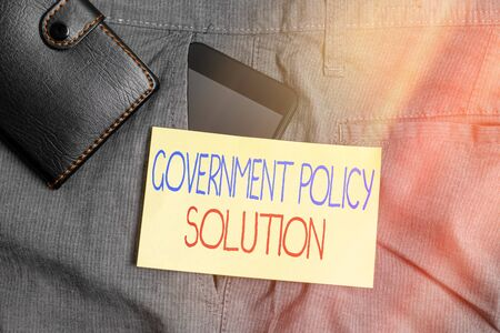 Word writing text Government Policy Solution. Business photo showcasing designed game plan created in response to emergency disaster Smartphone device inside trousers front pocket with wallet and note paper