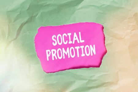 Word writing text Social Promotion. Business photo showcasing promoting a child to the next level regardless of skill Green crumpled ripped colored paper sheet centre torn colorful background Banco de Imagens