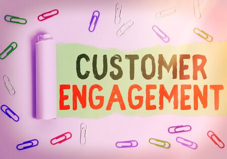 Text sign showing Customer Engagement. Business photo showcasing communication connection between a consumer and a brand Rolled ripped torn cardboard placed above a wooden classic table backdrop