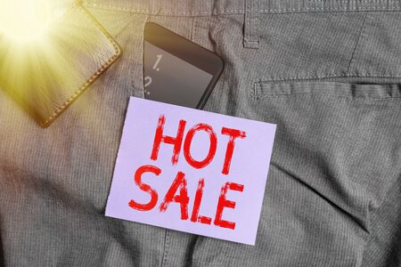 Writing note showing Hot Sale. Business concept for a very good discount of items is displayed over a limited time Smartphone device inside trousers front pocket with wallet