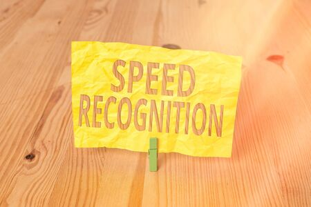 Conceptual hand writing showing Speed Recognition. Concept meaning interdisciplinary subfield of computational linguistics Wooden floor background green clothespin groove slot office