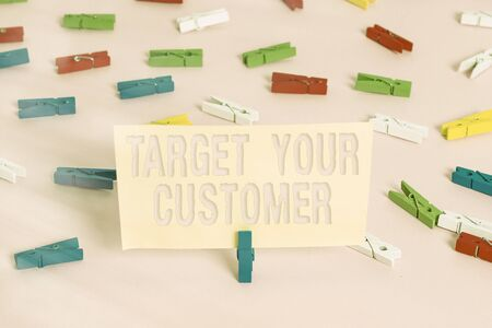 Conceptual hand writing showing Target Your Customer. Concept meaning attract and grow audience, consumers, and prospects Colored clothespin papers empty reminder pink floor office