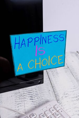 Word writing text Happiness Is A Choice. Business photo showcasing Stay happy no matter what Inspired Motivated Notation paper taped to black computer monitor screen near white keyboard Stock Photo