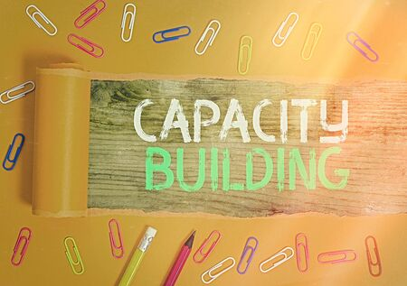 Conceptual hand writing showing Capacity Building. Concept meaning process by which individuals gain knowledge and skills