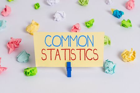 Conceptual hand writing showing Common Statistics. Concept meaning deals with collection analysis etc of numerical data Colored crumpled paper empty reminder white floor clothespin