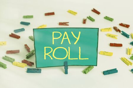 Word writing text Pay Roll. Business photo showcasing processing taxation and accounting to calculate salary payment Colored clothespin papers empty reminder white floor background office
