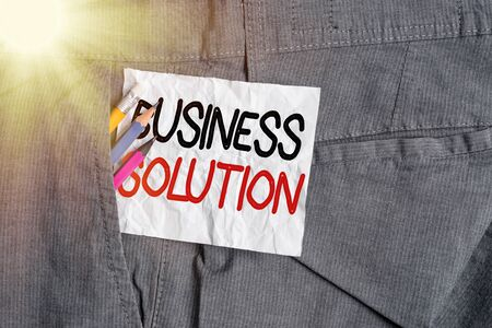 Text sign showing Business Solution. Business photo showcasing combination of ideas to help company achieve its objective Writing equipment and white note paper inside pocket of man work trousers