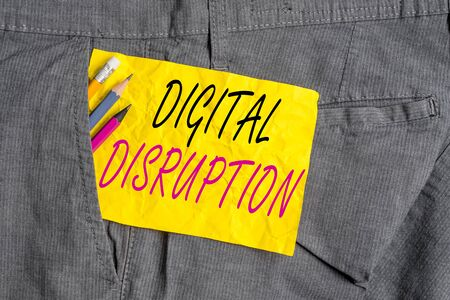 Word writing text Digital Disruption. Business photo showcasing occur when technologies affect value proposition of goods Writing equipment and yellow note paper inside pocket of man work trousers