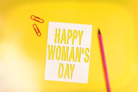 Conceptual hand writing showing Happy Woman S Day. Concept meaning to commemorate the essence of every lady around the world Pile of empty papers with copy space on the table
