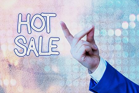 Writing note showing Hot Sale. Business concept for a very good discount of items is displayed over a limited time