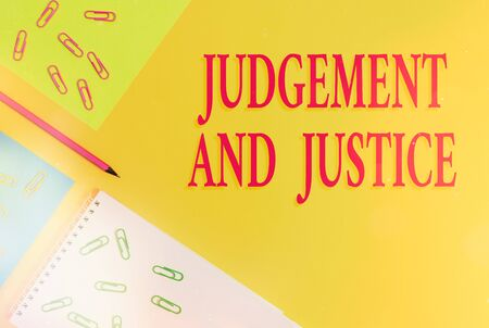 Text sign showing Judgement And Justice. Business photo showcasing law court proceedings to present evidence and finalize decision Blank paper sheets message pencil clips binders plain colored background