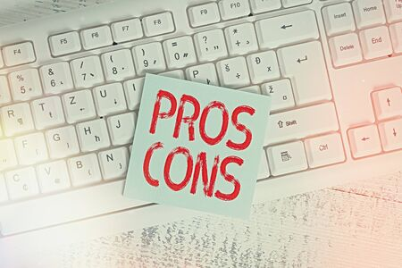 Conceptual hand writing showing Pros Cons. Concept meaning advantages and disadvantages observed while examining a product Keyboard office supplies rectangle shape paper reminder wood