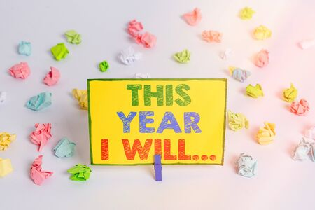 Writing note showing This Year I Will.... Business concept for things plan to do for a period of time Personal guide Colored crumpled paper empty reminder white floor clothespin