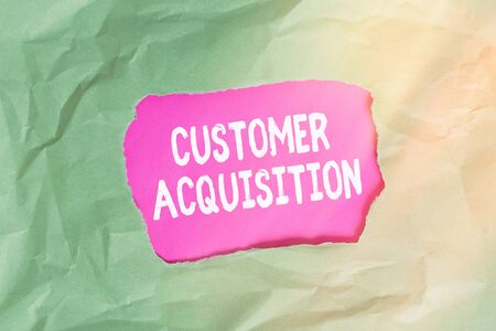 Word writing text Customer Acquisition. Business photo showcasing it refers to gaining new consumers to the business Green crumpled ripped colored paper sheet centre torn colorful background