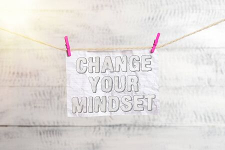 Handwriting text writing Change Your Mindset. Conceptual photo Personal development and career growth alteration Clothesline clothespin rectangle shaped paper reminder white wood desk