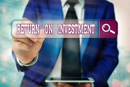 Writing note showing Return On Investment. Business concept for reviewing a financial report or investment risk analysis