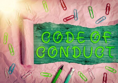 Writing note showing Code Of Conduct. Business concept for set of principles are ethics, respect, code, honesty, and integrity