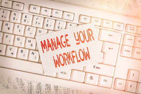 Writing note showing Manage Your Workflow. Business concept for Workforce organization and management to boost office productivity Keyboard office supplies rectangle shape paper reminder wood Stockfoto