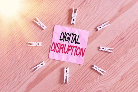 Writing note showing Digital Disruption. Business concept for occur when technologies affect value proposition of goods Colored clothespin papers empty reminder wooden floor background office