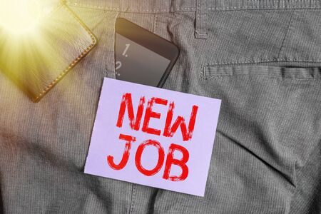 Writing note showing New Job. Business concept for starting afresh career with the given opportunity or employment Smartphone device inside trousers front pocket with wallet