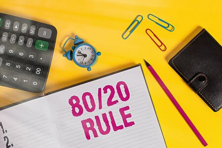 Handwriting text 80 Or 20 Rule. Conceptual photo law of the vital few as effect roughly resulted from a cause Open notebook wallet calculator clips pencil alarm clock color background