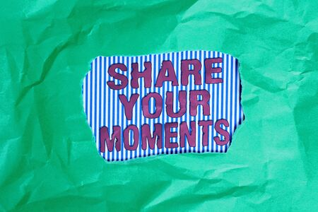 Conceptual hand writing showing Share Your Moments. Concept meaning a brief period of a good or bad time, capture it Green crumpled colored paper sheet torn colorful background Archivio Fotografico