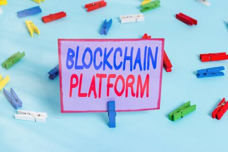 Writing note showing Blockchain Platform. Business concept for thing with a scripting language that solves many cases Colored clothespin papers empty reminder blue floor officepin Reklamní fotografie
