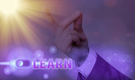 Text sign showing Learn. Business photo showcasing process of acquiring new modifying existing knowledge behaviors Stockfoto