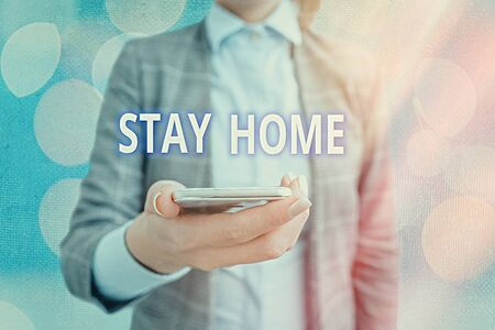 Conceptual hand writing showing Stay Home. Concept meaning not go out for an activity and stay inside the house or home Touch screen digital marking important details in business
