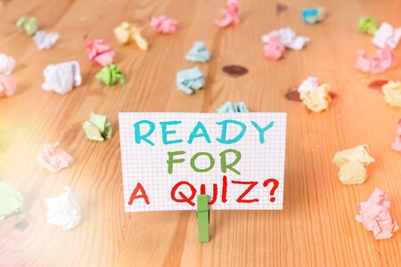 Conceptual hand writing showing Ready For A Quiz Question. Concept meaning Taking educational assessment Preparing an exam Colored crumpled papers wooden floor background clothespin