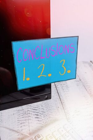 Word writing text Conclusions 1. 2. 3.. Business photo showcasing Lists of Suppositions Numbers of presumptions Notation paper taped to black computer monitor screen near white keyboard