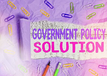 Text sign showing Government Policy Solution. Business photo text designed game plan created in response to emergency disaster Rolled ripped torn cardboard placed above a wooden classic table backdrop Stok Fotoğraf