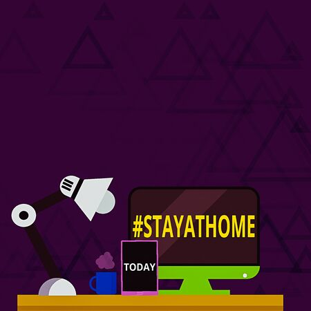 Writing note showing Hashtag Stay at home. Business concept for a trending label in social media related to the coronvirus outbreak Arrangement for Nightshift Worker Computer Tablet and Lamp
