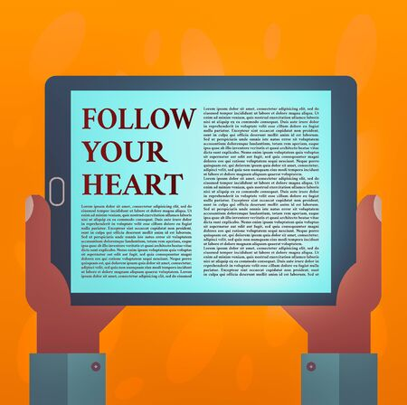 Writing note showing Follow Your Heart. Business concept for Motivation to do what is right and fulfill your desire Hu analysis Hand Holding Tablet Smartphone Display Unit photo Stok Fotoğraf