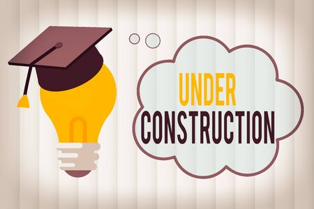 Text sign showing Under Construction. Business photo showcasing building that is unfinished but actively being worked on 3D Graduation Cap Thinking Resting on Bulb with Blank Cloud Thought Bubble Фото со стока